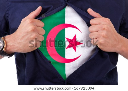 Young sport fan opening his shirt and showing the flag his algeria, algerian flag - stock photo