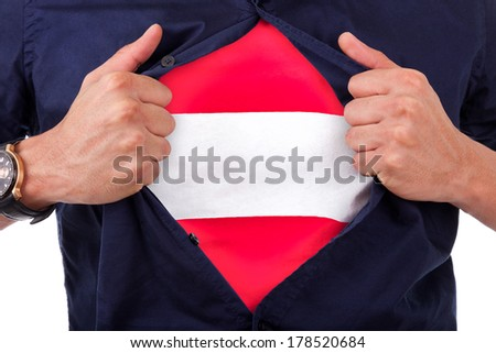 Young sport fan opening his shirt and showing the flag his country austria, austrian flag - stock photo