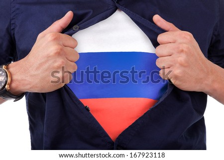 Young sport fan opening his shirt and showing the flag his south russia, russian flag - stock photo