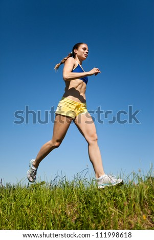 Young sport fitness woman running - stock photo