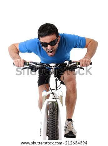 young sport man riding mountain bike training hard on sprint in fitness and competition concept wearing sunglasses and running clothes in final sprint isolated on white background - stock photo