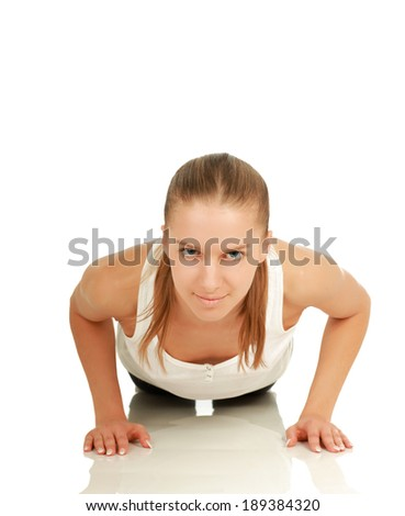 Young sport woman doing push up exercise, isolated on white background - stock photo