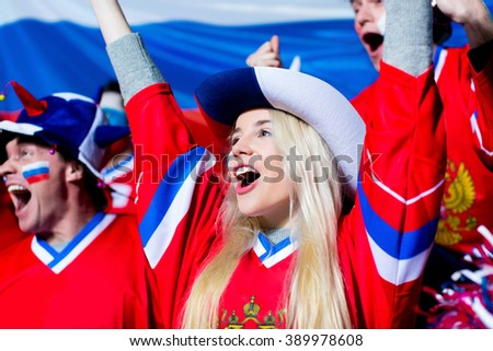 Young sports fans in stadium - stock photo