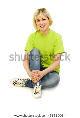 Young sports girl sitting on a white background
