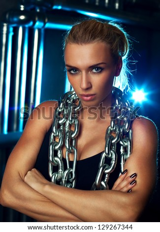 Young sports woman with heavy chain fashion portrait.