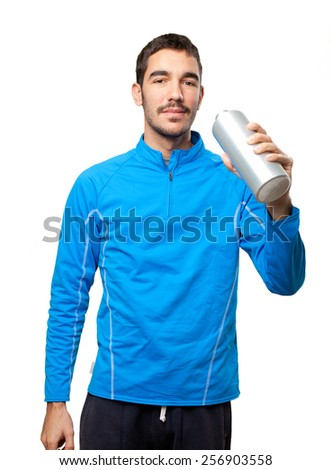 Young sportsman drinking - stock photo