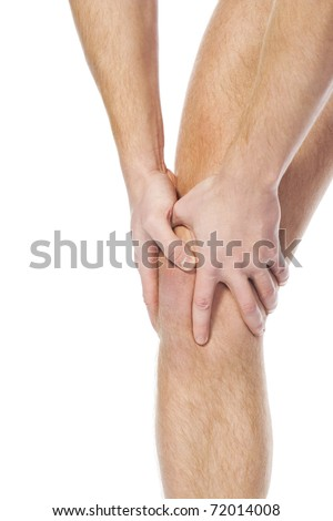 young sportsman has clasped hands a sick knee to reduce a pain. public health services concept - stock photo