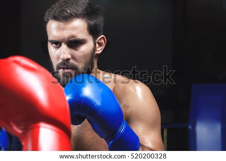 Young sportsman in boxing ring