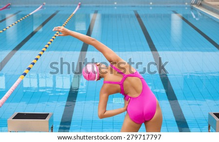 Young sportswoman stretching and preparing to swimming