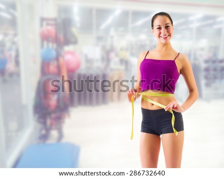 Young sporty girl at fitness club - stock photo