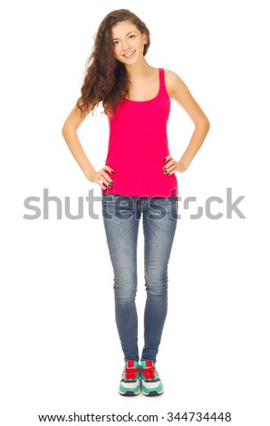 Young sporty girl in blue jeans isolated - stock photo