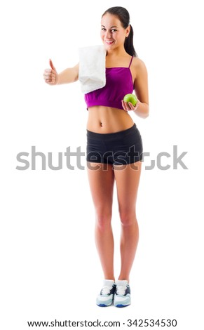 Young sporty girl with apple isolated - stock photo