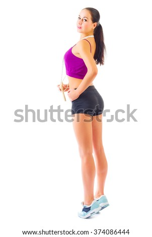 Young sporty girl with skipping rope isolated