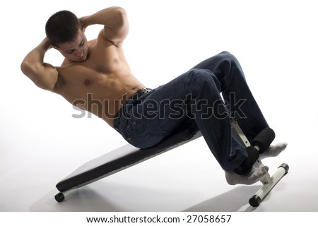 Young Sporty  Man Doing Special Exercise on White Background - stock photo
