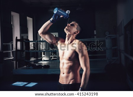 Young sporty man in the gym. Male boxer. Training.Mood,break, rest,, motivation, coach,water - sport concept. - stock photo