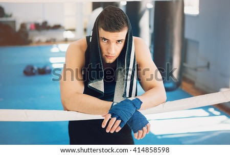 Young sporty man in the gym. Male boxer. Training. Mood, loss, break, rest, sad, motivation, coach - sport concept. - stock photo