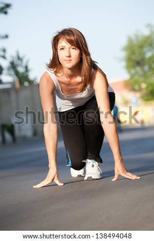Young sporty model running - stock photo