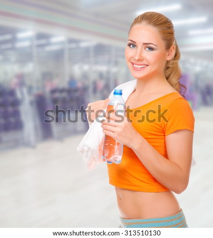 Young sporty woman at fitness club - stock photo