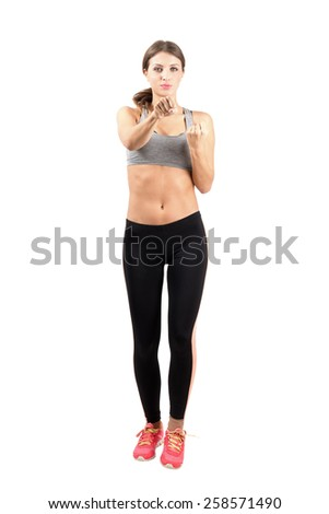 Young sporty woman boxing exercise. Full body length portrait isolated over white background. - stock photo