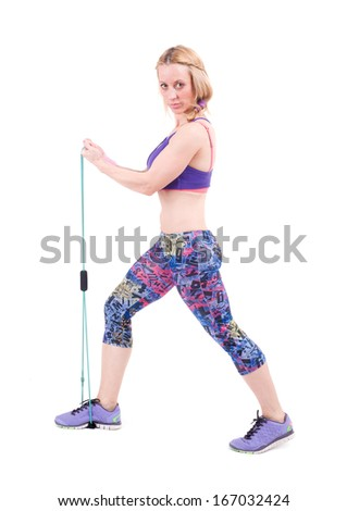 Young sporty woman exercising with a resistance rope. Isolated on a white background. Studio shot