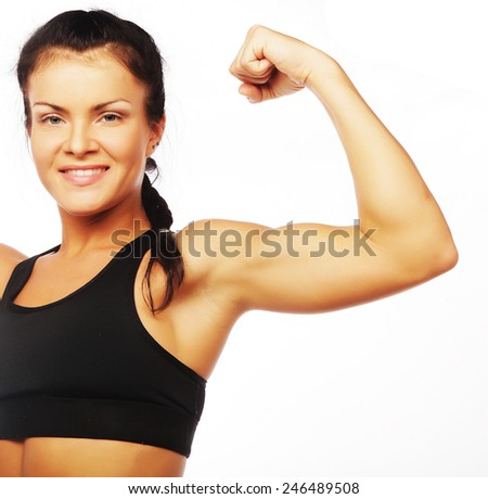 young sporty woman flexing her biceps isolated on white - stock photo