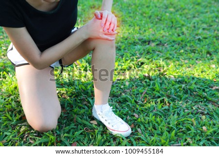 young sporty woman having knee pain (this image for sport injury concept)