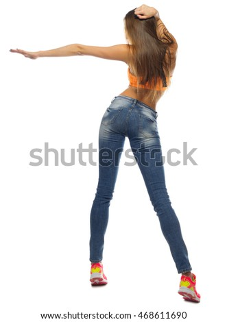 Young sporty woman in blue jeans isolated
