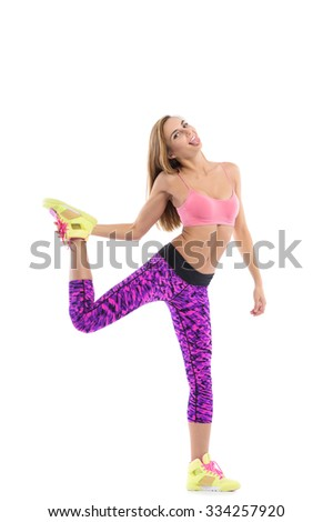 Young sporty woman in bright stylish fitness wear
