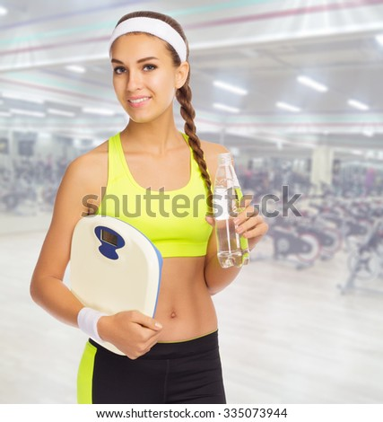Young sporty woman in fitness club - stock photo