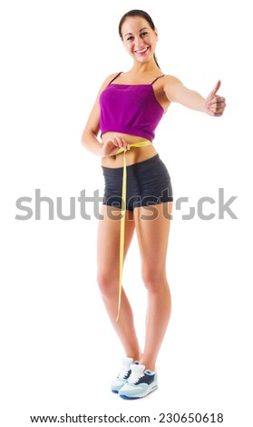 Young sporty woman with measurement tape isolated - stock photo