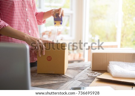 Young Start Up Small Business Owner Packing Cardboard Box At Workplace Freelance Woman Seller Prepare