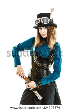 Young steampunk islolated girl on white wearing fancy hat. Fantasy old fashion with stylish topper goggle drawing gun.