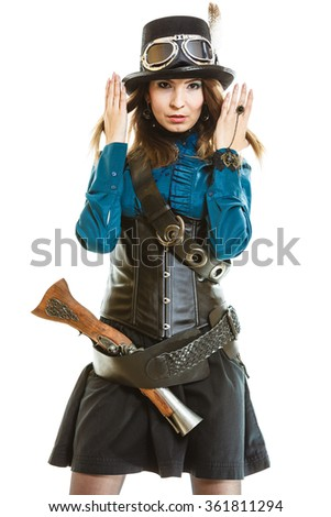 Young steampunk islolated girl on white wearing fancy hat. Fantasy old fashion with stylish topper and goggle holding hair.