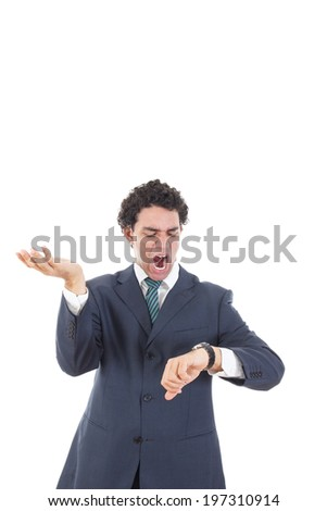 Young stressed businessman looking unpatiently at his wrist watch knowing it is too late - stock photo
