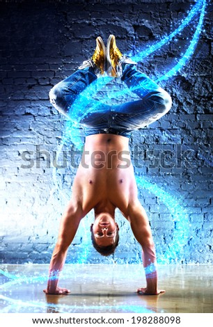 Young strong man with light effects. - stock photo