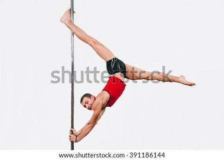 Young strong pole dance man isolated over white background - stock photo