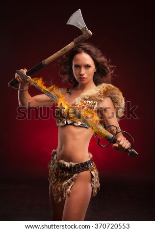 Young strong woman with axe. Riot woman