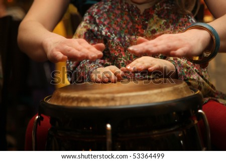 Young student and teacher at drum class - stock photo