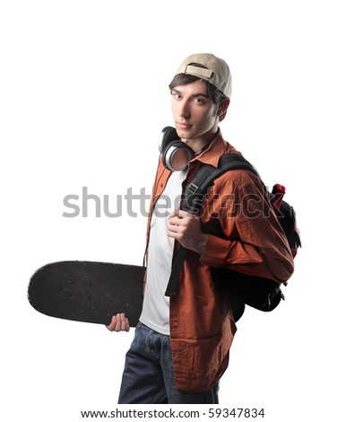 Young student carrying a skateboard and a rucksack - stock photo