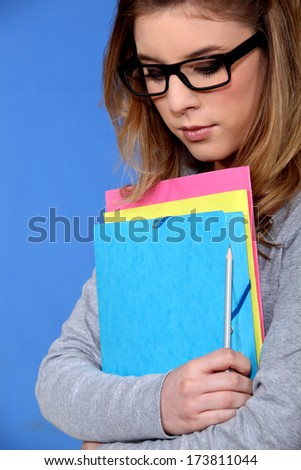 Young student carrying files - stock photo