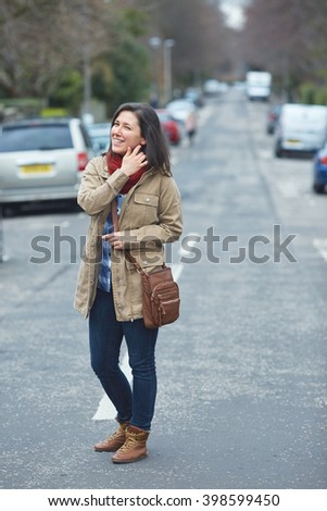 Young student female walk on the street, urban shoot - stock photo