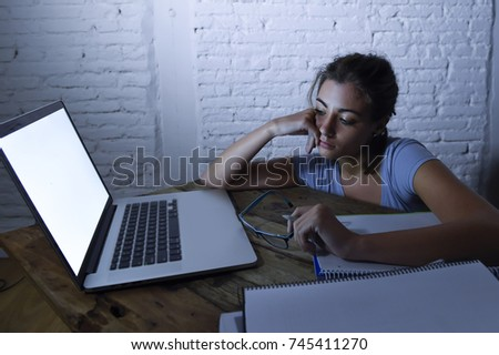 young student girl studying late night  tired at home laptop computer preparing exam exhausted and frustrated feeling stress and bored lying lazy on desk in lifestyle and education concept
