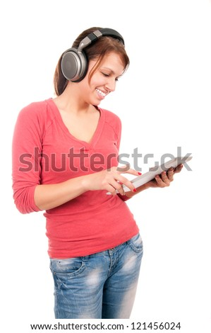 Young student girl with tablet pc and headphones - stock photo