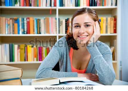 Young student in a library - stock photo