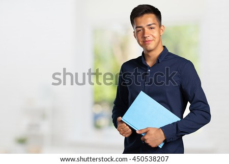 young student man with a book