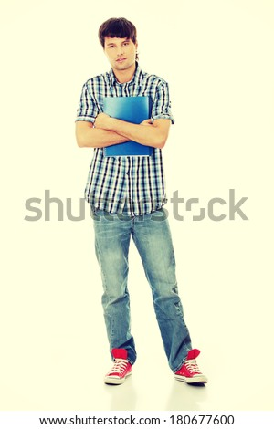 Young student man with notebook - stock photo