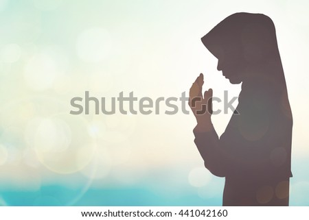 Young student muslim womans prayer blurred background. holy hope thinking vacation summer peace dreams soul life caucasian arabic koran mosque faith arab student zikr rise pray Orlando shooting ISIS  - stock photo