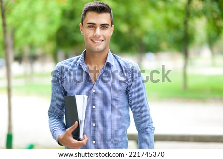 Young student outdoor  - stock photo