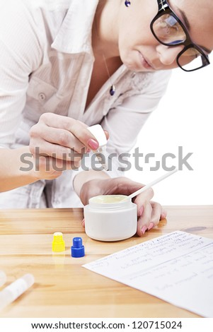young student preparing home made cosmetics - stock photo
