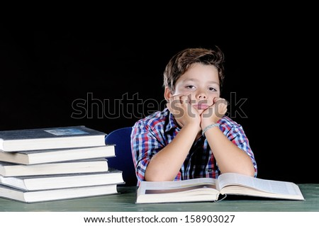 young student reading a book on a black background
